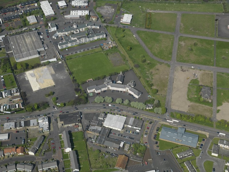 Oblique aerial view centred on St Francis' School, taken from the S.