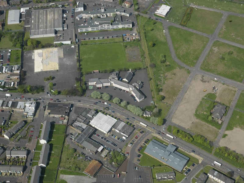 Oblique aerial view centred on St Francis' School, taken from the SSE.
