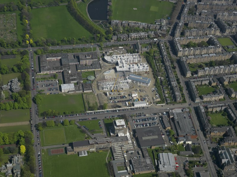 Oblique aerial view centred on the school with the Police Headquarters adjacent, taken from the W.