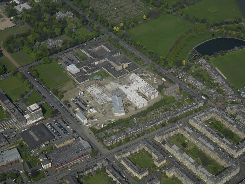 Oblique aerial view centred on the school with the Police Headquarters adjacent, taken from the SW.