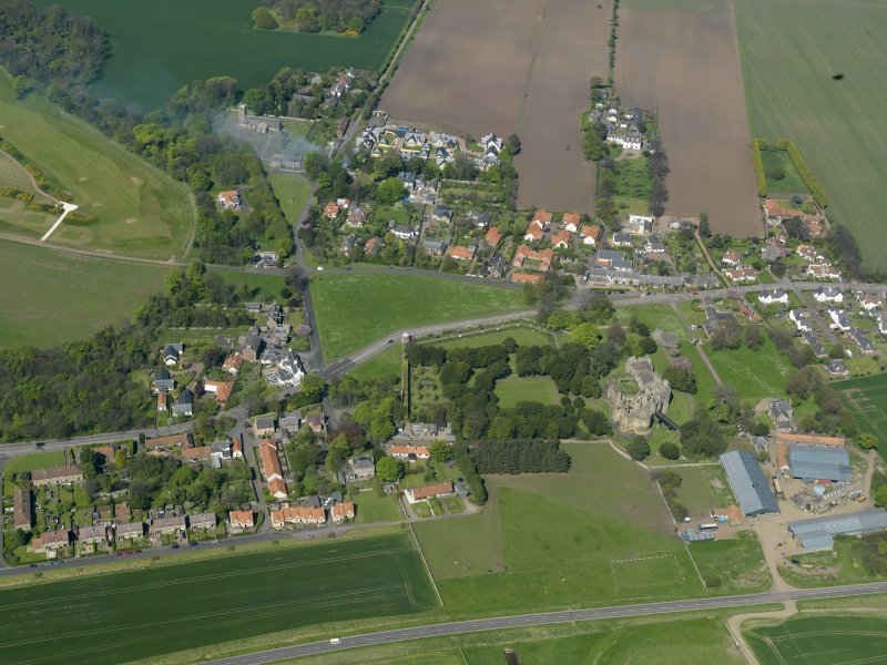 Oblique aerial view centred on the village with the castle adjacent, taken from the S.