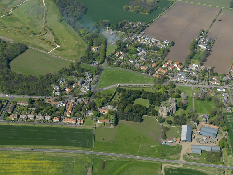 Oblique aerial view centred on the village with the castle adjacent, taken from the SSE.