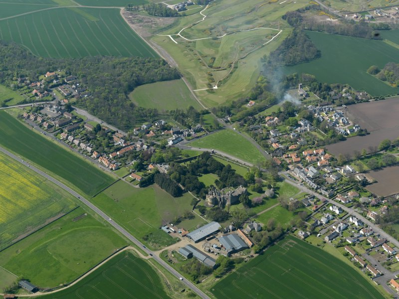 Oblique aerial view centred on the village with the castle adjacent, taken from the SE.