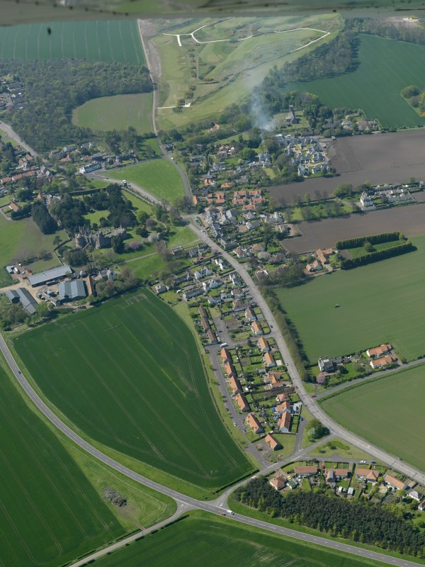 General oblique aerial view centred on the village with the castle adjacent, taken from the E.