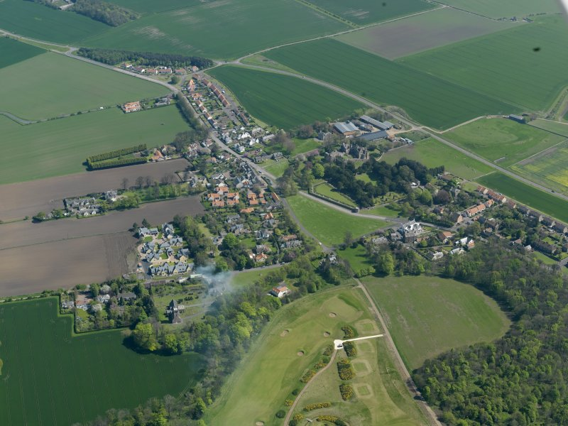 General oblique aerial view centred on the village with the castle adjacent, taken from the NW.