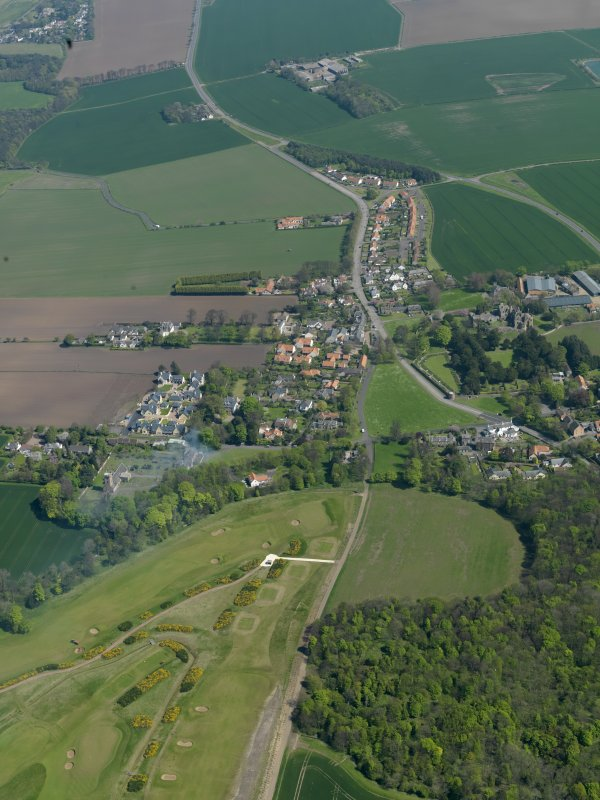 General oblique aerial view centred on the village with the castle adjacent, taken from the WNW.