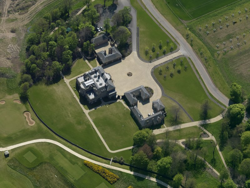 Oblique aerial view centred on the country house, taken from the NNE.