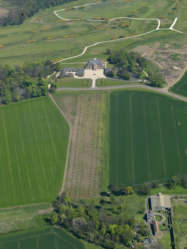 General oblique aerial view centred on the country house with the W approach adjacent, taken from the WSW.