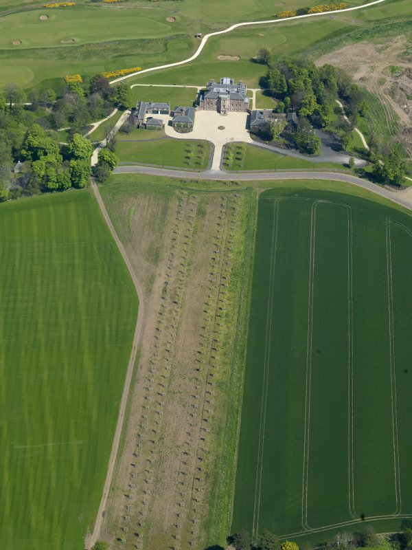 General oblique aerial view centred on the country house with the W approach adjacent, taken from the  SW.