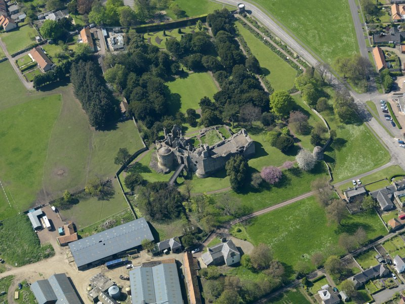 Oblique aerial view centred on the castle with the garden adjacent, taken from the E.