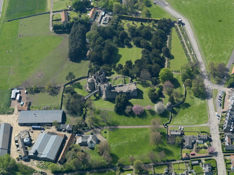 Oblique aerial view centred on the castle with the garden adjacent, taken from the ENE.