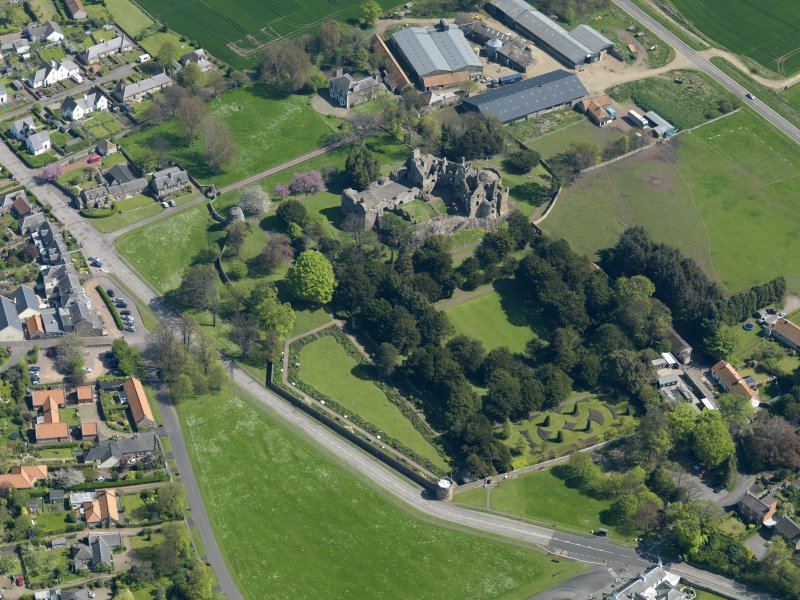 Oblique aerial view centred on the castle with the garden adjacent, taken from the WNW.
