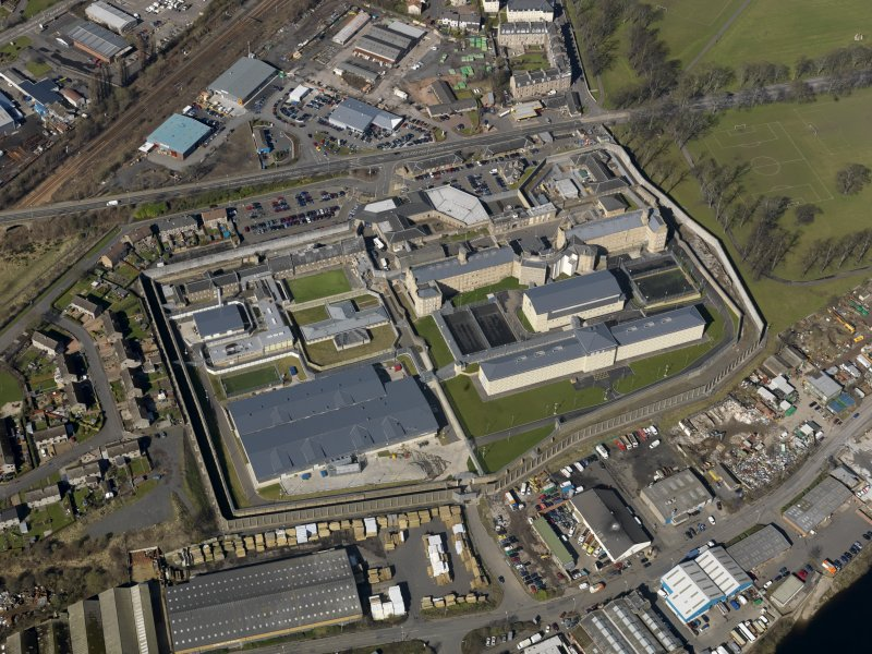 Oblique aerial view centred on the prison, taken from the SE.