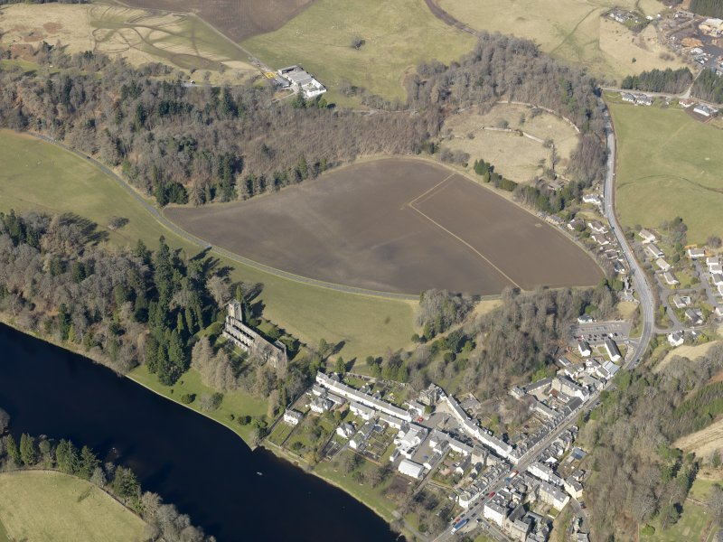 General oblique aerial view centred on the soilmarks of the garden features with the cathedral and village adjacent, taken from the SE.