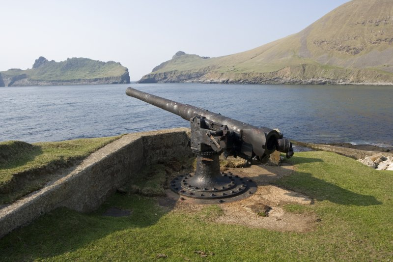 A steel and concrete built gun-emplacement guards the pier at St Kilda village (NF19NW 1). The gun and sunken magazine were completed during October 1918 after a bombardment by a U-boat the previous May. View from NE.