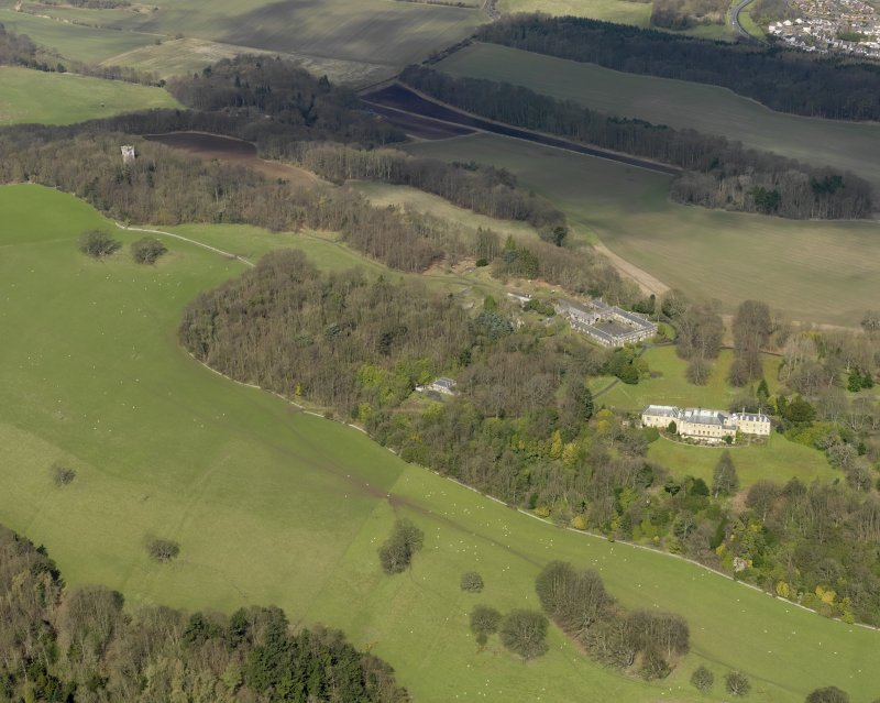 General oblique aerial view centred on the house with the stable block adjacent, taken from the SSE.