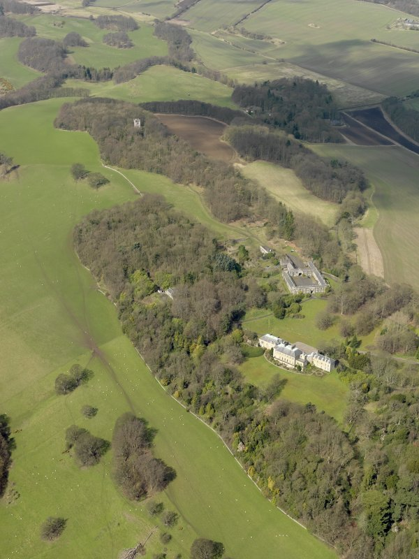 General oblique aerial view centred on the house with the stable block adjacent, taken from the ESE.