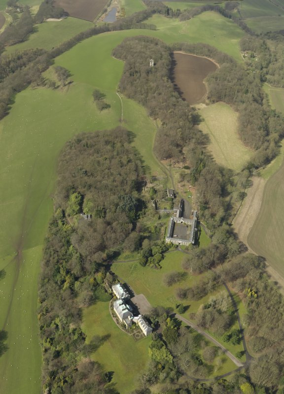 General oblique aerial view centred on the house with the stable block adjacent, taken from the E.