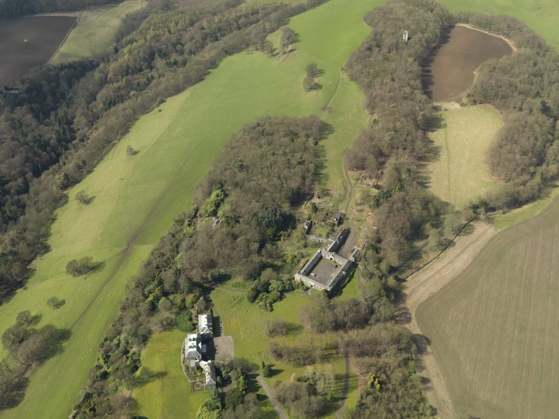 General oblique aerial view centred on the house with the stable block adjacent, taken from the ENE.