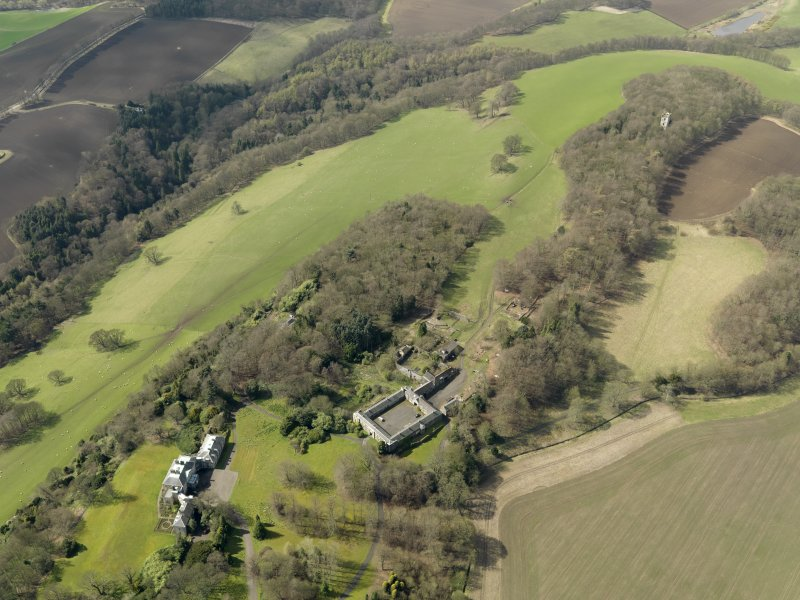 General oblique aerial view centred on the house with the stable block adjacent, taken from the NE.