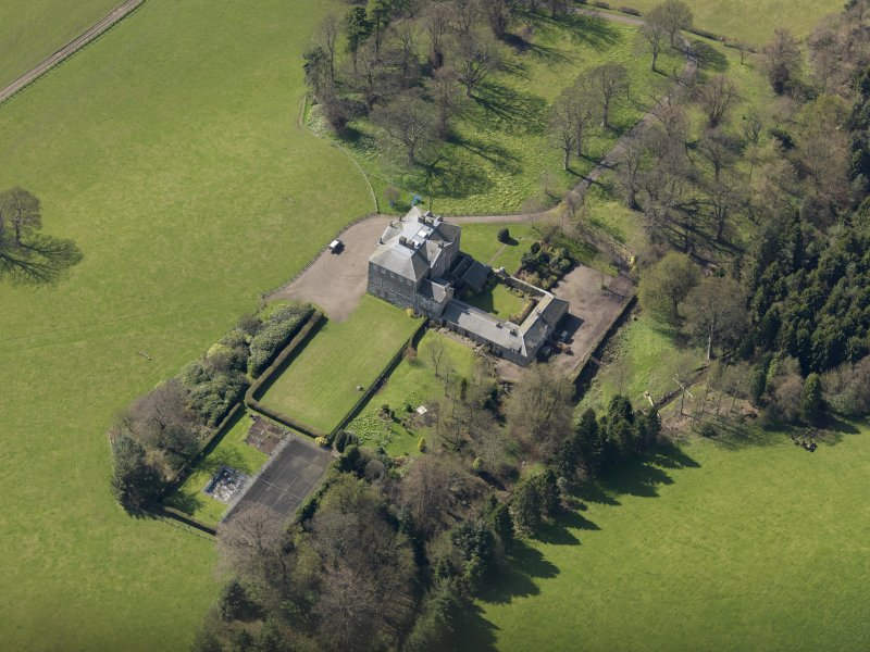 Oblique aerial view of the house with the office court adjacent, taken from the NE.