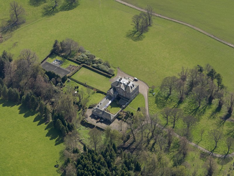 Oblique aerial view of the house with the office court adjacent, taken from the NW.