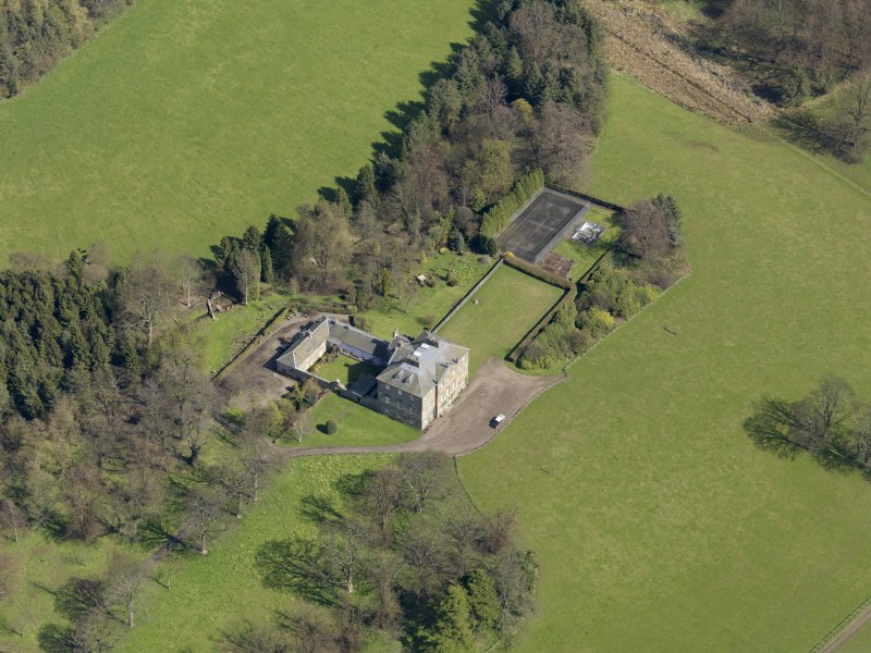 Oblique aerial view of the house with the office court adjacent, taken from the WSW.