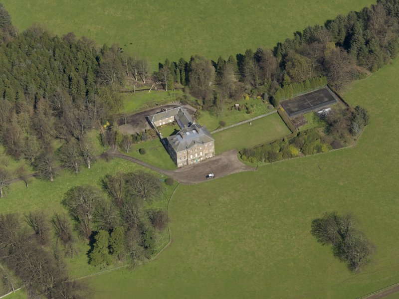 Oblique aerial view of the house with the office court adjacent, taken from the SW.