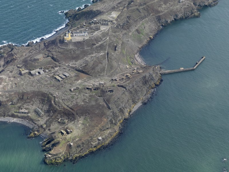 Oblique aerial view centred on Inchkeith northern defences and New Lighthouse, taken from the NW.