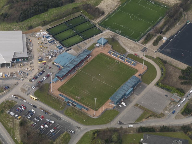 Oblique aerial view centred on the football ground, taken from the SE.