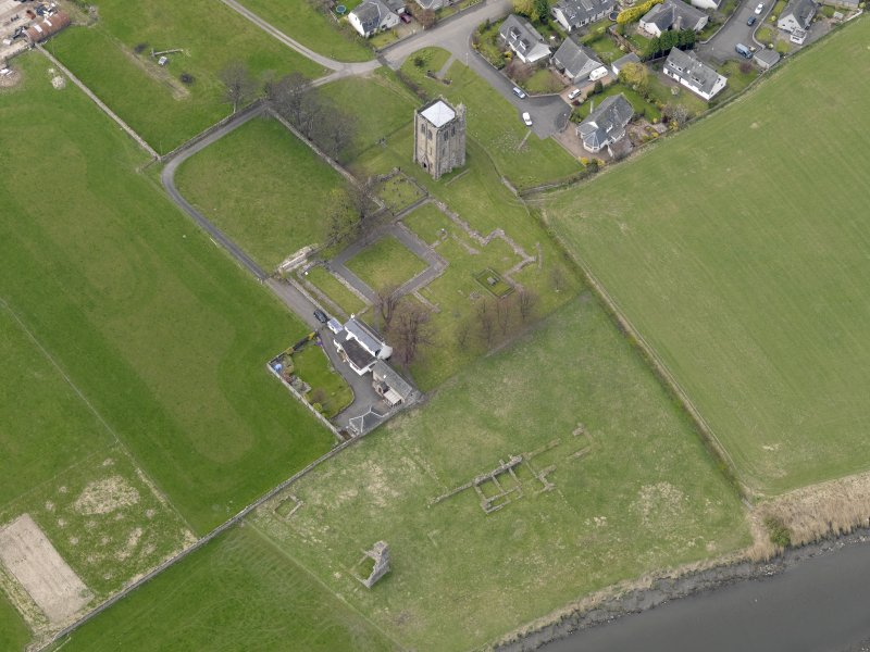 Oblique aerial view centred on the remains of the Abbey, taken from the SE.