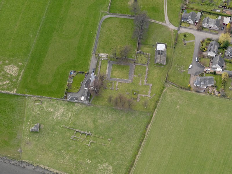 Oblique aerial view centred on the remains of the Abbey, taken from the E.