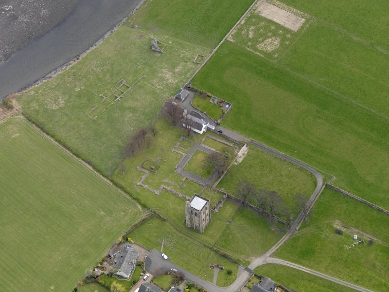 Oblique aerial view centred on the remains of the Abbey, taken from the NW.