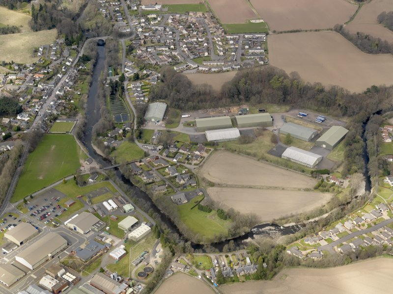 Oblique aerial view centred on the Naval Stores Depot, taken from the SW.