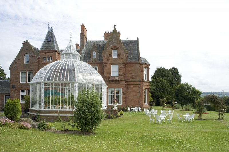Conservatory and house. View from SW