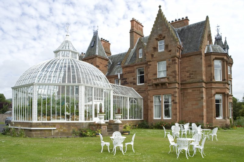 Conservatory and house. View from SSW