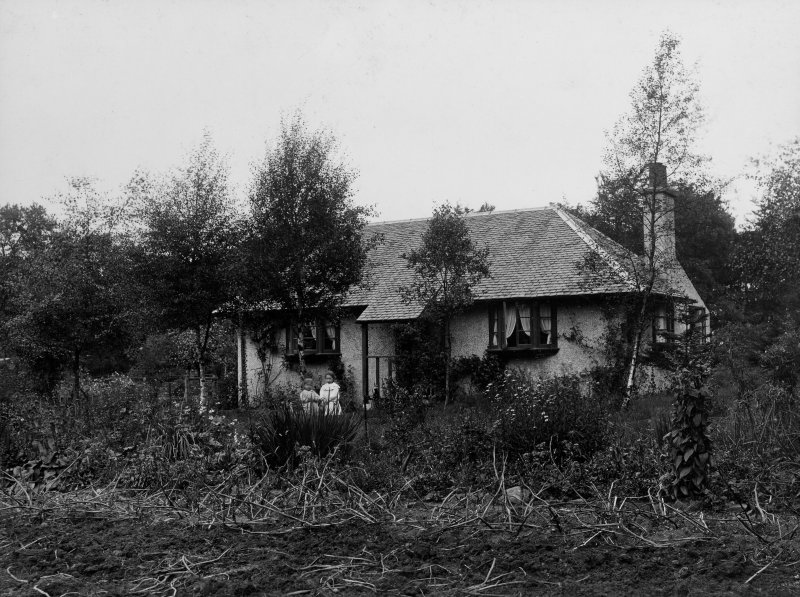 View of one storey dwelling house showing two girls.