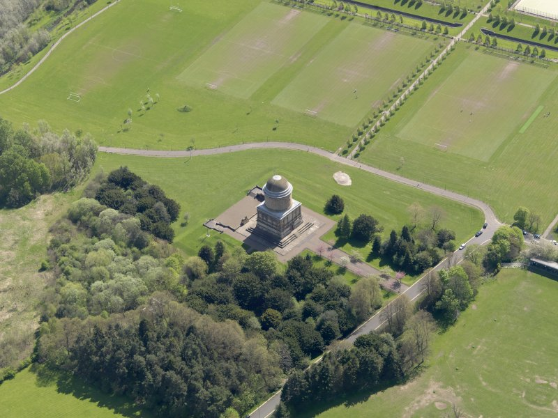 Oblique aerial view centred on the mausoleum, taken from the NW.