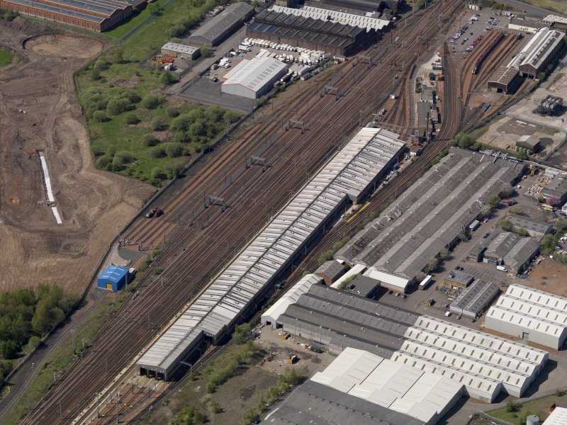 Oblique aerial view centred on the modern traction depot, taken from the E.
