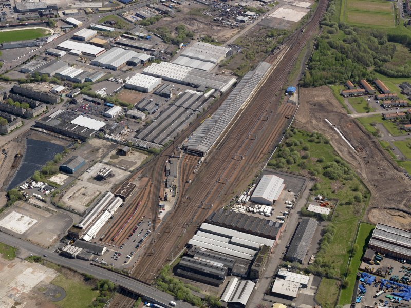 Oblique aerial view centred on the surviving section of the original motive power depot with the modern traction depot adjacent, taken from the W.