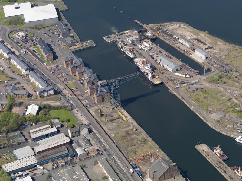 Oblique aerial view centred on the dock, taken from the SE.