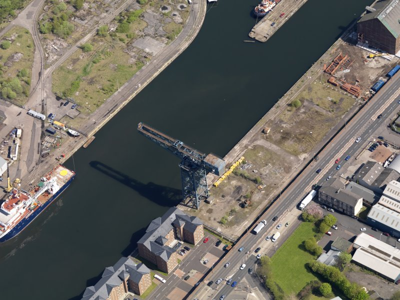 Oblique aerial view centred on the dock with the crane adjacent, taken from the WNW.