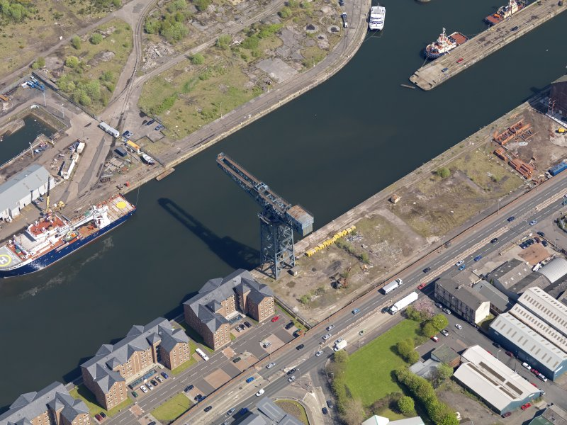 Oblique aerial view centred on the dock with the crane adjacent, taken from the SW.