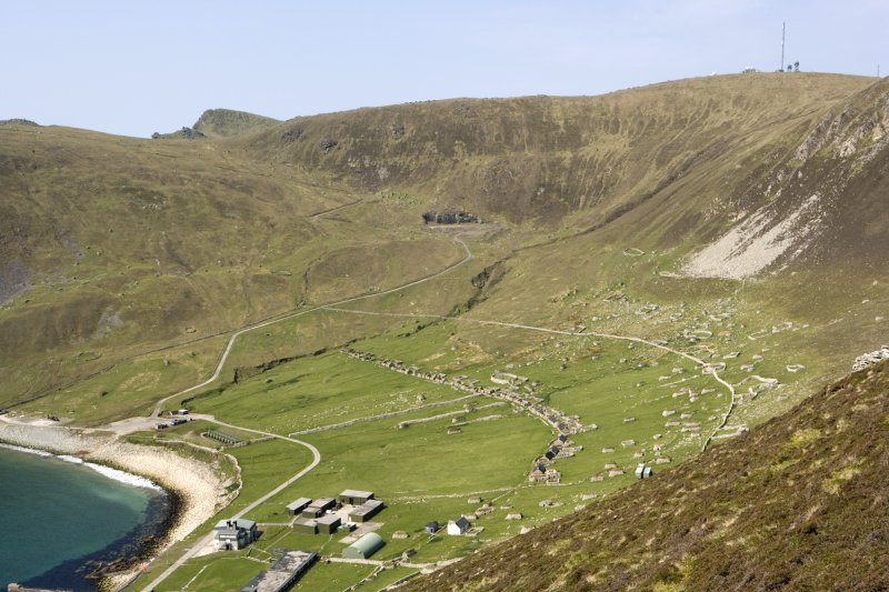 Hirta, Village Bay. General view from SE showing the Street, crofts and head dyke, and including the Ministry of Defence Establishment and the radar station on Mullach Mor.