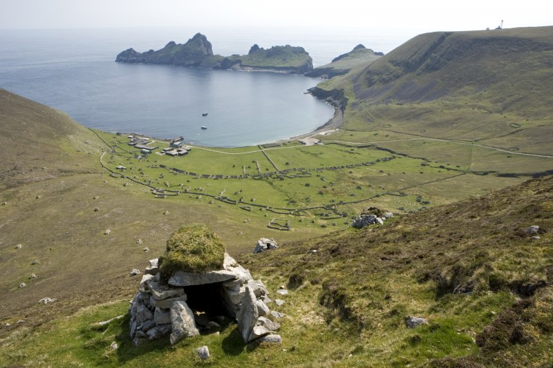 Village Bay, Hirta, St Kilda.  General view from N with cleit in foreground, including the Ministry of Defence Establishment, the radar station on Mullach Sgar and Dun beyond.
