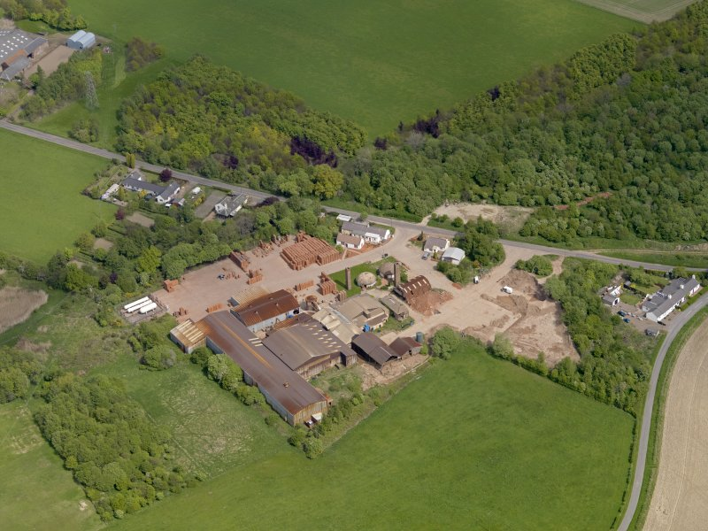 Oblique aerial view centred on the brickworks, taken from the SW.