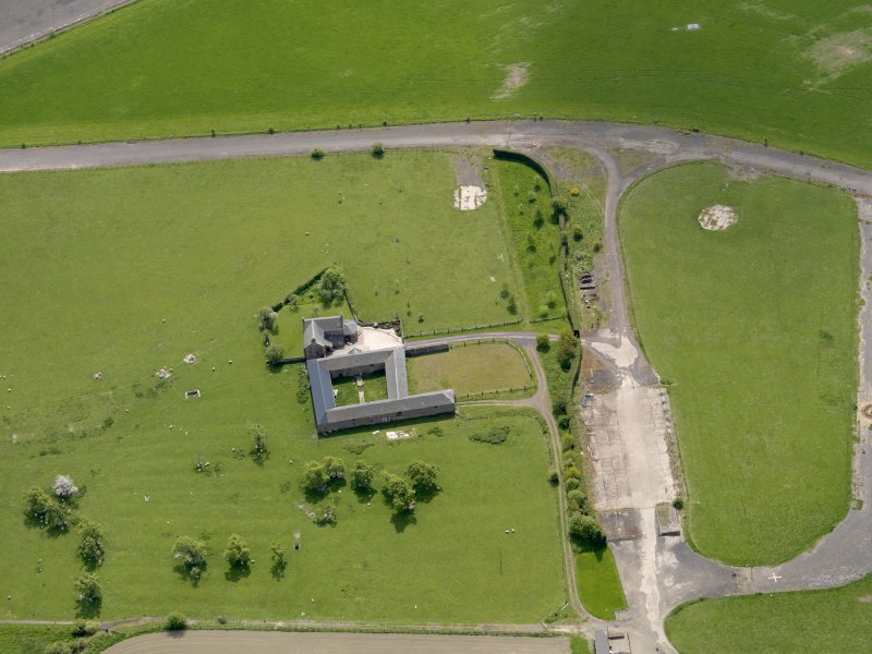 Oblique aerial view centred on Muirhouses Farmsteading with the control tower adjacent, taken from the NNW.
