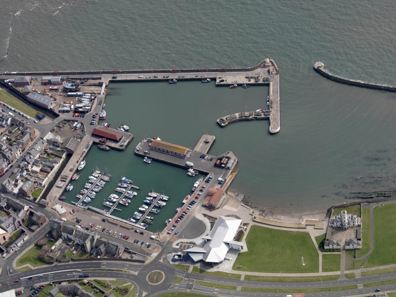 Oblique aerial view centred on the harbour, taken from the NW.