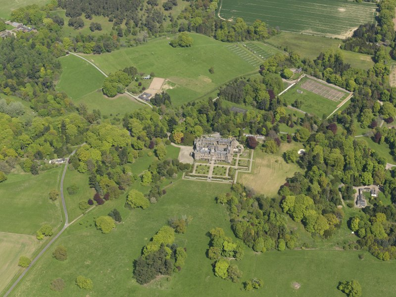 General oblique aerial view centred on the country house with the policies and gardens adjacent, taken from the SW.