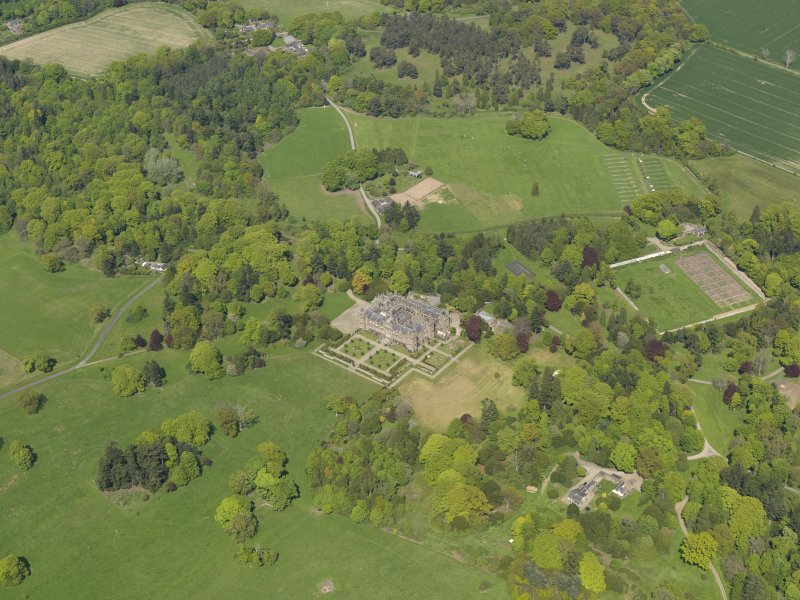 General oblique aerial view centred on the country house with the policies and gardens adjacent, taken from the  SSW.